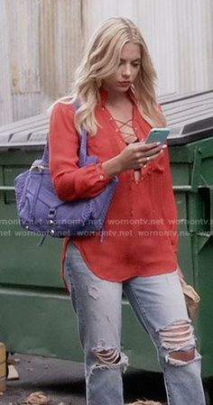 Hanna's red lace-up blouse and ripped jeans on Pretty Little Liars.  Outfit Details: https://wornontv.net/56043/ #PLL
