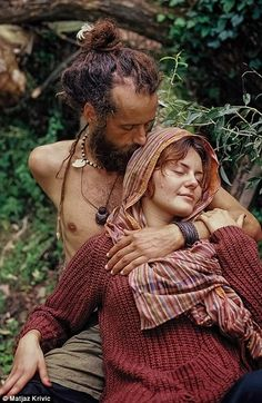A couple rest together at the Hungary World Rainbow Gathering 2014