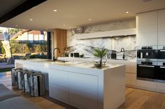 Love the drawers,  the splash back and the wood panelling