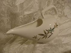 Love the shape of this creamer! I have a sugar bowl + cups and dessert plates in this pattern