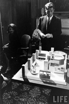 Jackie and Bobby Kennedy study a model of the Kennedy Library.   This version was to be built on the grounds of Harvard, but local residents blocked the construction.    It was then re-designed and built outside Boston.