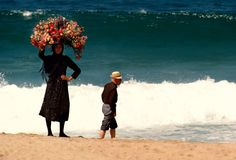 """unrar: """" Portugal, Strolling the beach at Nazare 1985, Bruno Barbey. """""""