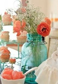 Love the blue mason jars with coral or peach flowers and baby's breath. Perfect easy centerpieces for a turquoise and coral wedding :)