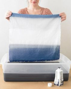 Dip dye fabric - This would make an amazing, inexpensive piece of art for the living room. Use an old bed sheet and some ocean-y blues. Hang with two bulldog clips.