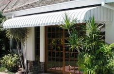 Installing a clear pergola roof was the best decision ever. It has turned our side yard is a three season patio that we can enjoy in any weather. Strawberry Planters, Side Yards, Pergola With Roof, Patio, Building, Outdoor Decor, Home, Buildings, Ad Home