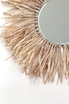Create this round raffia sunburst mirror yourself and bring those boho, island vibes into your home! decor diy mirror Make this Tropical-Inspired Raffia Sunburst Mirror Diy Home Crafts, Decor Crafts, Diy Home Decor, Design Crafts, Kids Crafts, Boho Diy, Bohemian Decor, Diy Deodorant, Deco Boheme