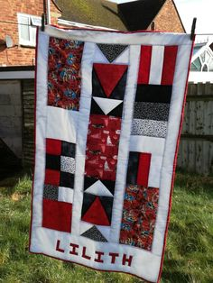 Lil Heroes. A baby quilt, finished in February 2017. Designed and made by me. Hand pieced, hand quilted in the ditch and name hand appliqued.