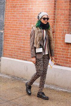 Preetma Singh matches her leopard trousers with a cute leopard beanie.