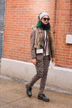 Preetma Singh matches her leopard trousers with a cute leopard beanie.