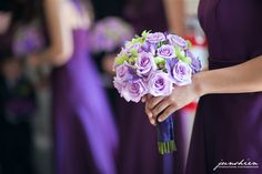 Gorgeous bouquet set off against the colour of the bridesmaids dresses in the background  - monochromatic love