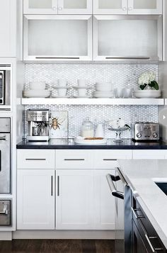 Combo of white & stainless steel cabinets; stainless steel floating shelf; mini marble hex tile