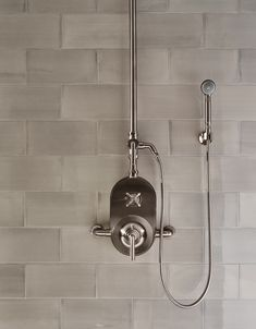 Influenced by the connection of industry and art Henry easily transitions between modern, traditional, utilitarian and classic settings. Classic Bathroom, White Bathroom, Bathroom Cabinetry, Contemporary Bathroom Designs, Shower Systems, Kitchen Tile, Modern Traditional, Bath Rugs, Shower Heads