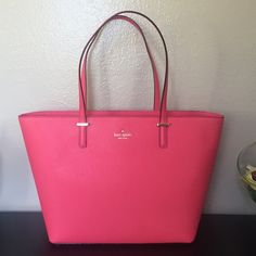 SALE BNWT Kate Spade large tote Beautiful tote, the color is its original blush pink color (has a tint of orange). Has gold hardware. Inside the bag has 1 zipper compartment and 2 open compartments. The bag has zipper closure. For full price I will include dust bag! Sale from 238! Last picture is model post. kate spade Bags Totes