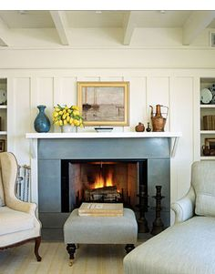 American Cottage Family Room -- love the blue tone of the fireplace surround