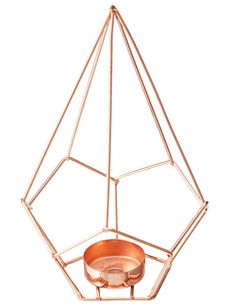 Add an on-trend statement to your home with this copper tealight holder from the Tilly@home Dune collection.