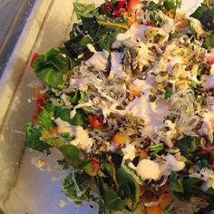 Tahini Sauce :) it has shredded rainbow chard, purple kale, green kale ...