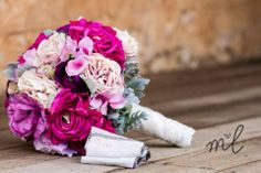 Pinks and purples looked perfect in this bouquet. Designed by Amour Flowers