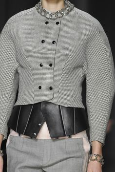 Grey jacket with rounded shape & black leather accents; structured fashion details // Balenciaga