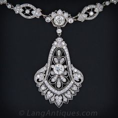 Cartier Diamond and Platinum Necklace c.1929, An absolutely stunning, transitional style - late Edwardian / early Art Deco - platinum and diamond necklace signed Cartier. This magnificent treasure is accompanied by Cartier's original bill of sale from New York - dated January 18, 1929.