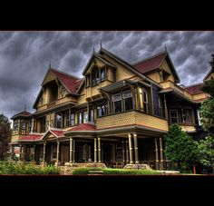 The Winchester House, San Jose, California. There are those who believed Sarah Winchester was curse by the ghosts   that lead her to built this strange and unusaul house. Read her story.