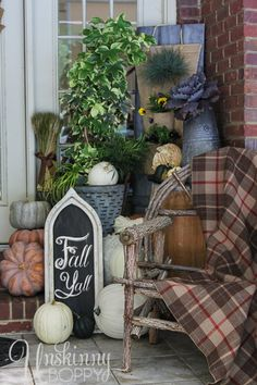 Fall porch with rustic browns/ blues and plaids. Love the Fall, Y'all sign and the plaid thrown over the wooden chair!
