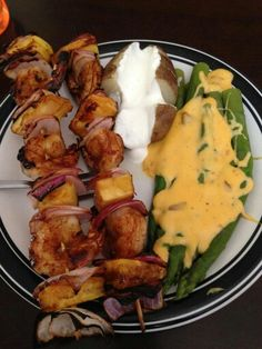 Shrimp pineapple and red onion teriyaki kabobs baked potato with sour cream and boiled asparagus with creamy Velveeta cheese amazing dinner!!!