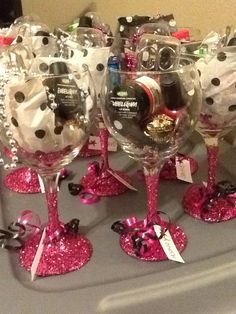 Bachelorette favors with #lushcosmetics and dollar store wine glasses! Modge podge glitter, baileys Bon Bon, and nail stuff!
