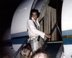 Boarding a plane after his concert in Dallas, TX on June 6,1975 (Elvis didn't start using the Lisa Marie until November 1975)
