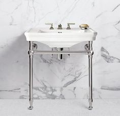 I love the square bathroom sink with metal frame.