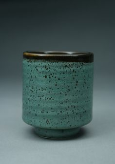 Cone 6 electric  Volcanic ash 82  Whiting 8.3  Lithium carbonate 7.6  Gerstley borate 2.1  Bentonite 1  Magnesium carbonate 5  add  6% Black copper carbonate  10% Tin  This is the blue green glaze over the Tenmoku style glaze which is breaking the surface like an oil spot glaze.