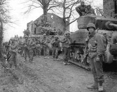 Accompanied by M4A3 tanks, soldiers of the 9th Infantry Division of the U.S., concentrated near Bath, on February 27, 1945.
