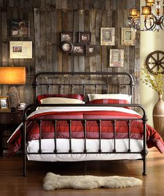 A steel framed bed is a perfect match for the assorted colors of the wood in the back #steampunk #steampunkdecor