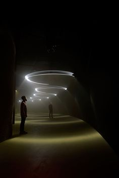"United Visual Artists ""Momentum"" - a multi-sensory installation that immerses the observer in light and sound, turning the corridor into a musical instrument, to which pendulums dance above"