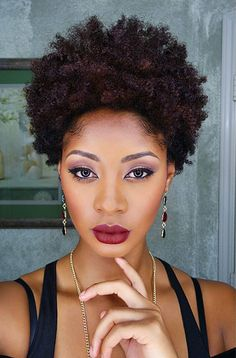 Carmen rocking colored natural hair achieved WITH chemicals. But it's possible to color natural hair without them.