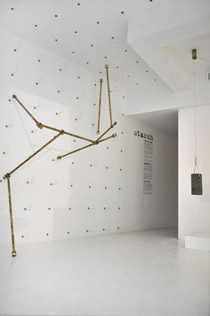 Ghaith & Jad build brass rod installation inside Beirut boutique.