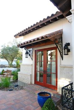 Wi dow detail with wrought iron bracket Custom Home- Spanish Mediterranean in Cordillera Ranch mediterranean porch Front Door Awning, Door Overhang, Porch Roof, Side Porch, Spanish Style Homes, Spanish House, House With Porch, House Front, Hacienda Style