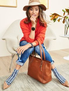 Our favorite holiday outfit? Bright sweaters, socks and pointed toe heels, boyfriend jeans and of course the Q Wander rose gold display smartwatch.