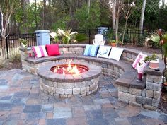 firepit...I like that half is the rounded bench and on the other side could be comfy outdoor chairs!