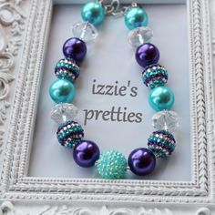 Purple and turquoise gumball necklace by Izzie's Pretties. Pearls and sparkles? Yes please!