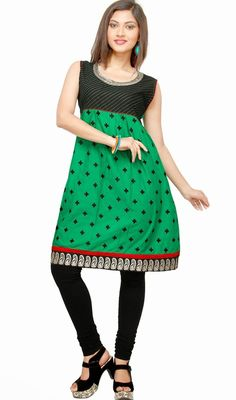 Transform yourself into a graceful diva dressed in this black and green cotton sleeveless tunic. Beautified with block print, lace, patch and resham work. #LatestClassicalKurtis