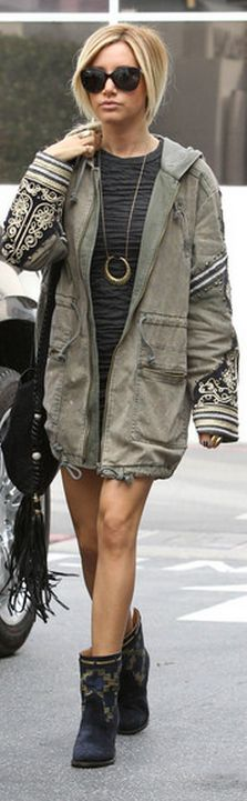 Who made  Ashley Tisdale's green coat, black fringe handbag, black long sleeve dress, and boots that she wore in Los Angeles on December 13, 2012?