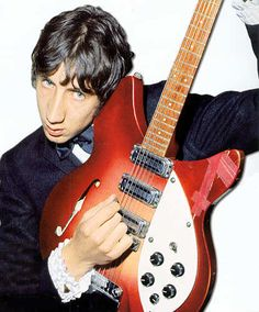 townshend holding a rose morris model rickenbacker. this is THE rickenbacker to have. violin hole, three pickups, 21 frets.