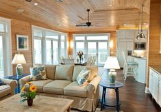 united states knotty pine walls living room rustic with wood paneling mount ceiling lights flooring Cabin Living Room, White Wood Paneling, Knotty Pine Living Room, Knotty Pine Decor, Knotty Pine Walls, White Living Room Decor, Wood Paneling Living Room, Pine Wood Flooring, Rustic Living Room