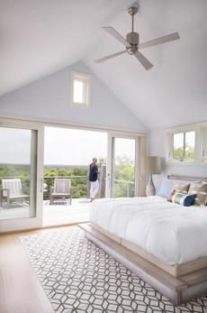 airy bedroom on the Vineyard with cathedral ceiling and pattenred rug: