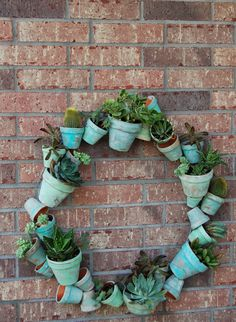 By the Way: Clay Pot Wreath + Succulents = Smile! Succulent Soil, Succulent Wreath, Cacti And Succulents, Succulent Ideas, Clay Pot Projects, Clay Pot Crafts, Shell Crafts, Recycled Wine Bottles, Outdoor Wreaths