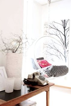 my scandinavian home's beautiful barcart & swinging chair