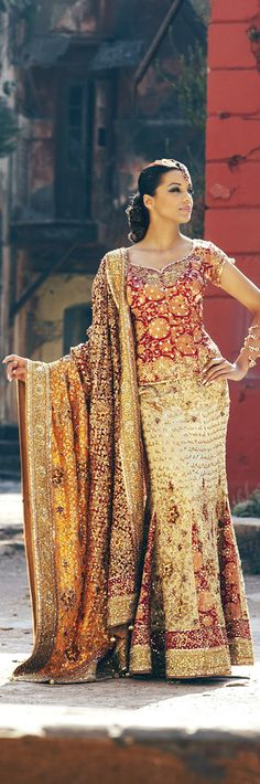 sweetheart neckline, beautiful red and creamy gold-----Call me crazy, but I wish I was Hindu simply so I could wear their GORGEOUS, colorful gowns