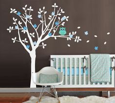 This is a tree wall decal set that includes a very cute owl. It is easy to apply and is guaranteed to brighten any room, especially a baby nursery, baby's room, kid's room, children's room, or playroom. Choose colors (see the color section below) that compliment your interior space or make it perfect for a boy's room or a girl's room! You can even arrange the owl, leaves, and blossoms how you'd like so it will fit any wall space.