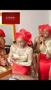 Ore-iyawo in red and gold. Prefer the shade of red in the other pin of bridesmaids in velvet skirts.