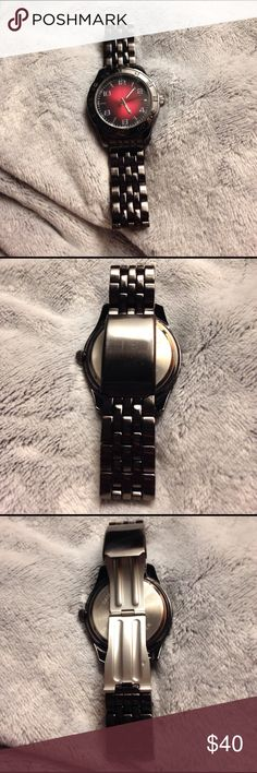ALLUDE BLACK STAINLESS STEEL/BEZEL WRIST WATCH Unisex stainless steel & black bezel metal wrist watch by ALLUDE. Needs a battery. Beautiful black and red face with large numbers. Adjustable. Excellent condition and keeps good time! ALLUDE Accessories Watches